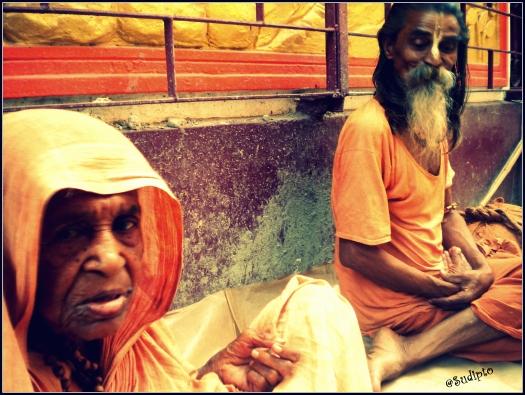 Aged couple beside a temple in Dhakuria, Kolkata