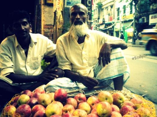 An old man selling apples near Lal bazar, Kolkata